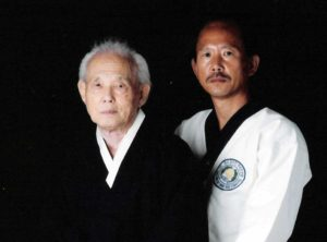 Moo Duk Kwan® Founder Hwang Kee and Moo Duk Kwan® President H.C. Hwang